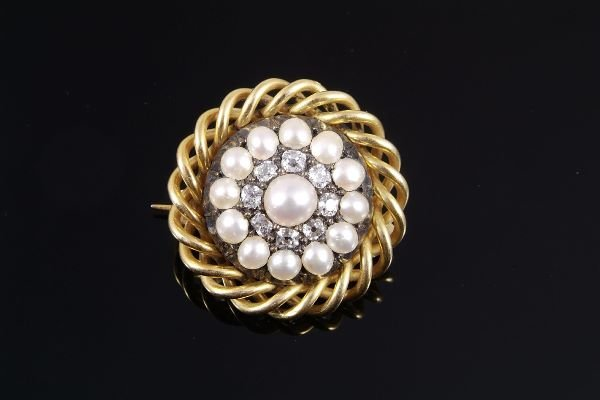 1015: A late Victorian pearl and diamond brooch, circa