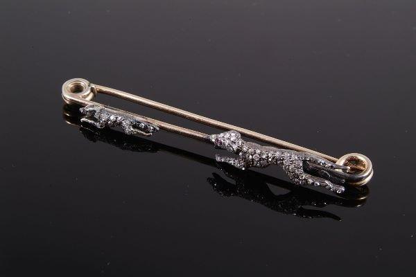 1016: A late Victorian diamond set hunting brooch, circ