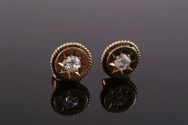 1017: A pair of Victorian diamond single stone ear stud