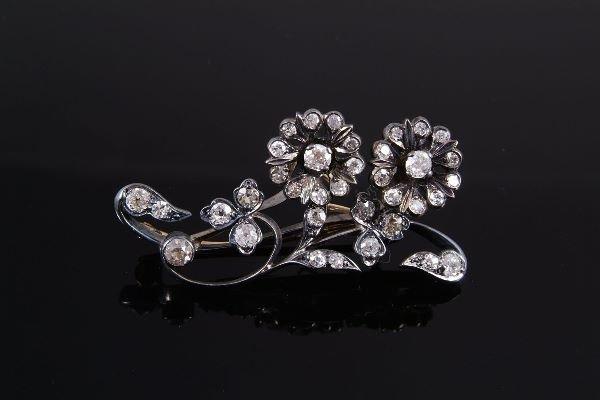 1018: A Victorian diamond spray brooch, circa 1880, set