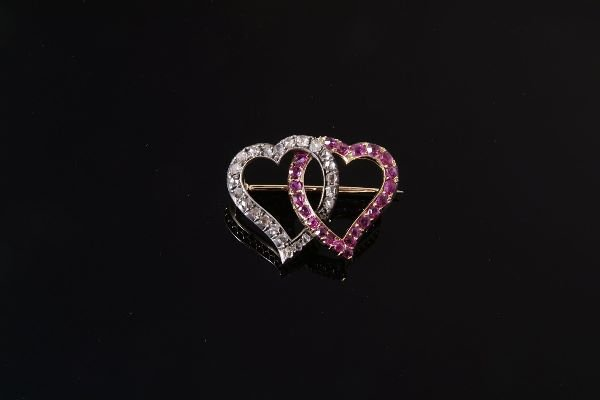 1023: A late Victorian ruby and diamond double heart br