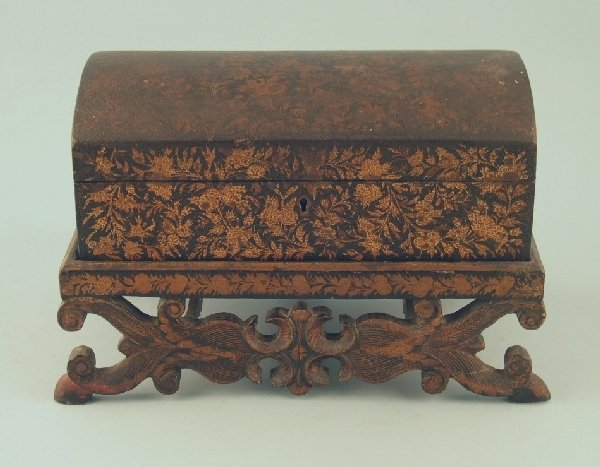 2019: An Indian gilt and black lacquered box and stand,