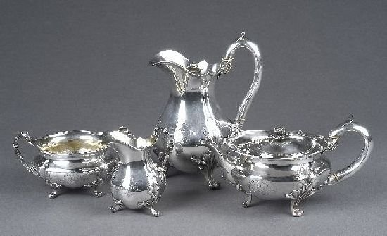 3015: A George IV silver four piece tea set by Benjamin
