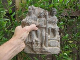 Gandhara, 3 Devotees with gifts to Buddha, carved stone