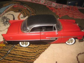 1956 Red Black Plymouth diecast car model;
