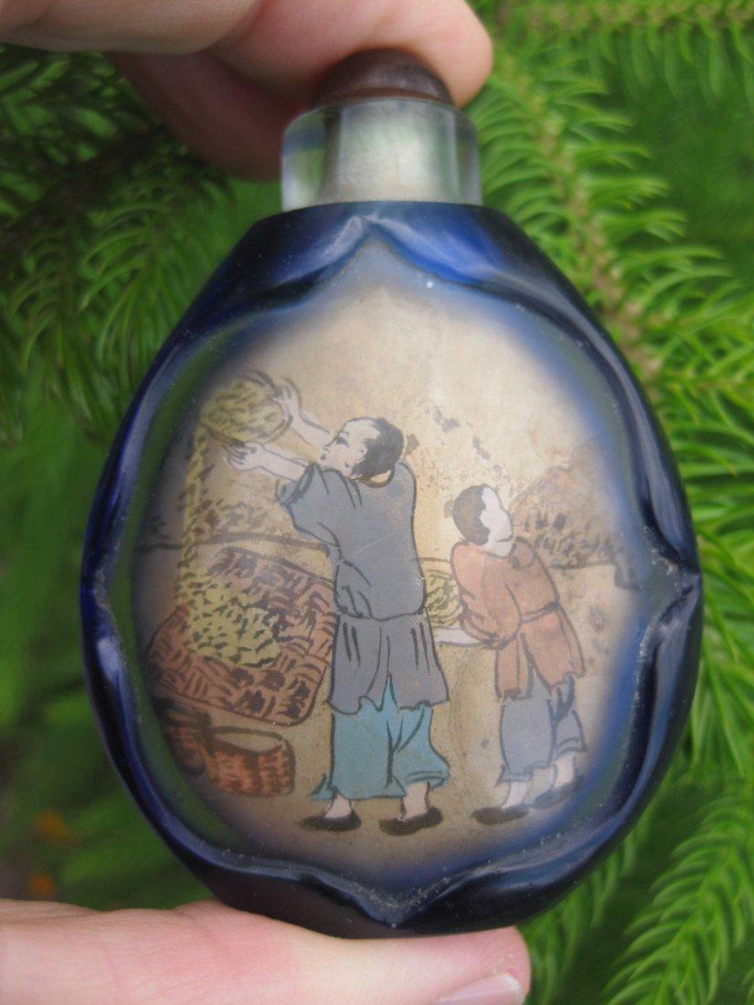 Chinese snuff blue bottle: Peasants thrashing rice Qing