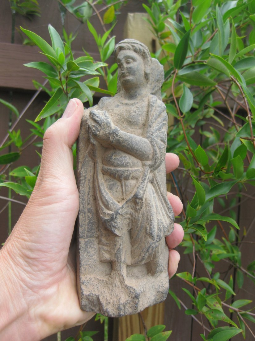 Gandhara carved stone, 1 Devotee with gift to Buddha