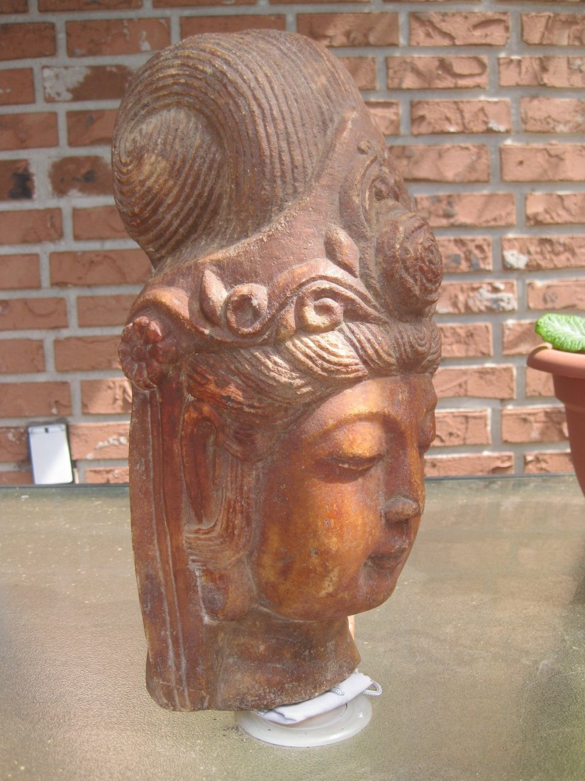 Carved stone head of Guan Yin, 35 lb