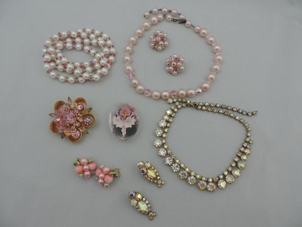 A GROUP OF PINK IRIDESCENT JEWELRY