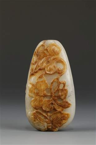 A PALE CELADON AND RUSSET JADE SNUFF BOTTLE of fruit fo