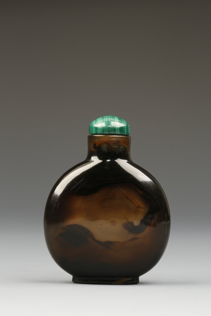 A CHALCEDONY SNUFF BOTTLE of rounded form, the dark bro