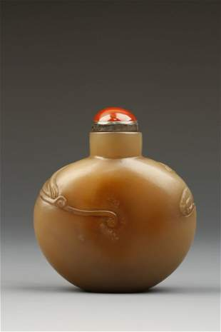 A SOAPSTONE SNUFF BOTTLE of rounded form with warm brow