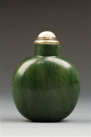 A SPINACH JADE SNUFF BOTTLE of ovoid form with darker g