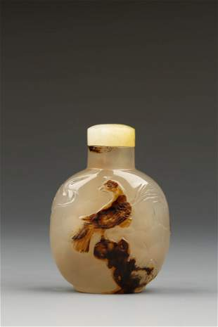 A CHALCEDONY SNUFF BOTTLE of ovoid form, the greyish-br