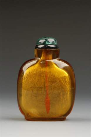 AN AMBER-COLOURED GLASS SNUFF BOTTLE of rounded rectang