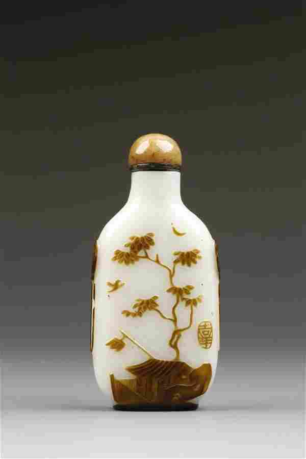 A SEPIA-OVERLAY WHITE GLASS SNUFF BOTTLE of narrow form
