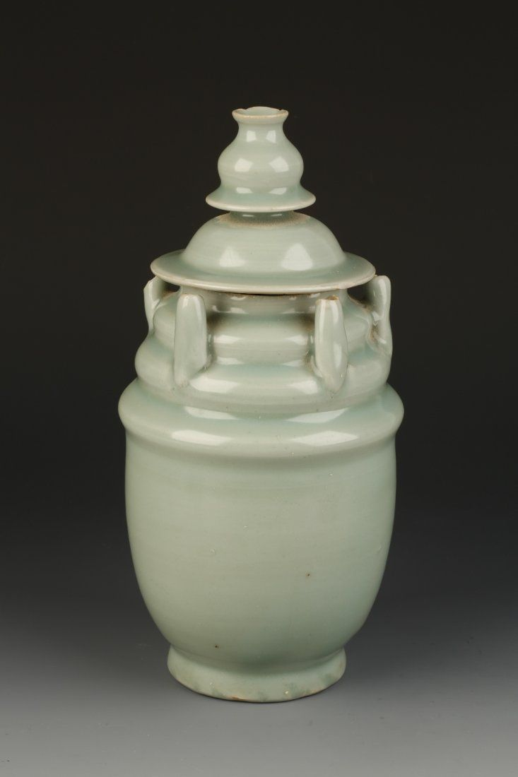 A LONGQUAN CELADON FIVE-SPOUTED JAR with a double domed