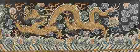 A SILK AND GOLD THREAD EMBROIDERED PANEL showing a five