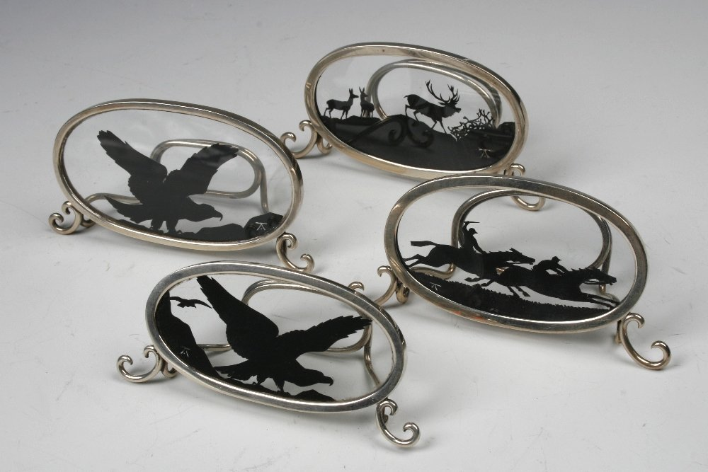 A HARLEQUIN SET OF FOUR MENU CARD HOLDERS of oval form,