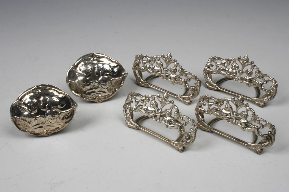 A SET OF FOUR VICTORIAN MENU CARD HOLDERS of oval pierc
