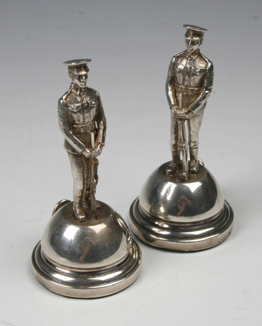 A PAIR OF CAST MENU CARD HOLDERS modelled as soldiers h