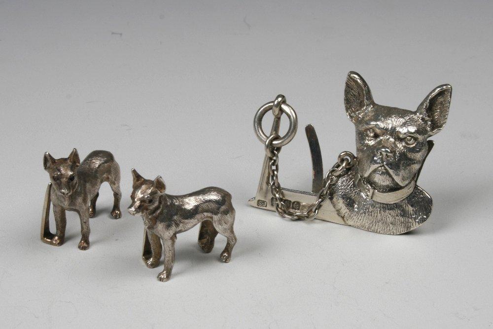A CAST VICTORIAN MENU CARD HOLDER modelled as a dog's h