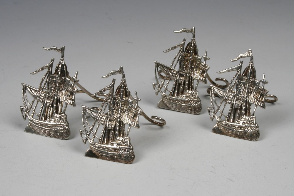 A SET OF FOUR VICTORIAN MENU CARD HOLDERS modelled as s