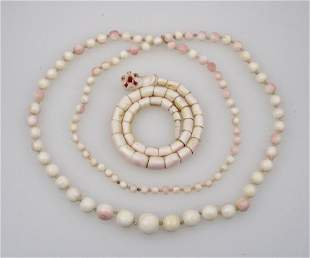 A GRADUATED SPHERICAL SHELL BEAD NECKLACE with pink ove