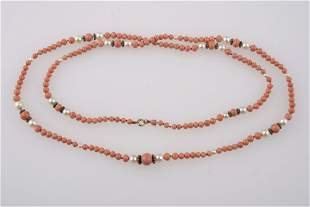 A CORAL BEAD NECKLACE interspersed with nine sections o