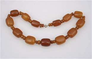AN AMBER BEAD NECKLACE with large rectangular and small