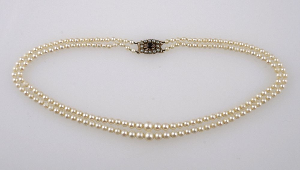A DOUBLE ROW CULTURED PEARL NECKLACE of graduated form,