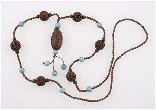 A CHINESE HEIDAO NUT BEAD NECKLACE, each bead carved to