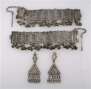 A PAIR OF EASTERN WHITE METAL ANKLETS of fancy gate-lin