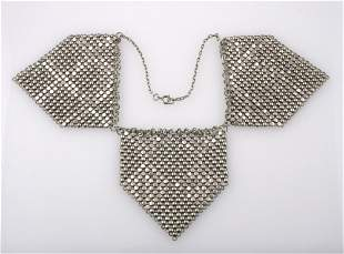 """A 1960'S WHITE METAL """"HANDKERCHIEF"""" NECKLACE, formed fr"""