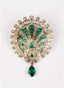 AN ART DECO EMERALD AND DIAMOND BROOCH modelled in the