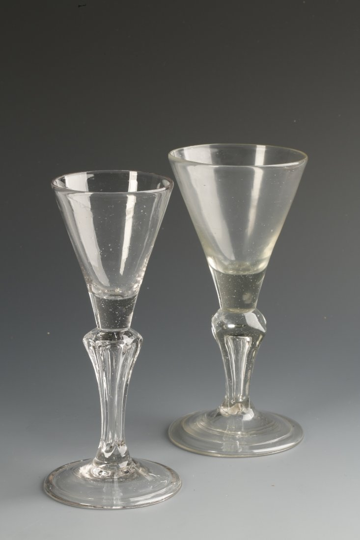 AN 18TH CENTURY WINE GLASS with a trumpet-shaped bowl o