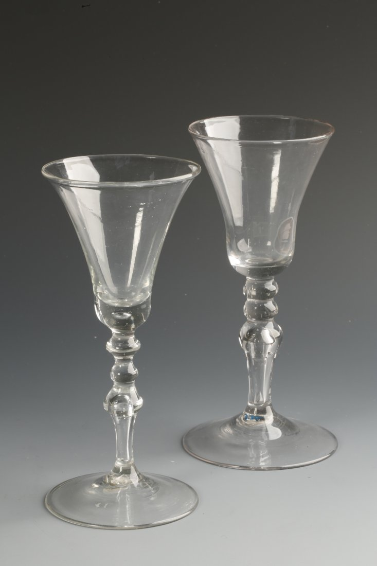 AN 18TH CENTURY WINE GLASS with a flared bowl on a mult