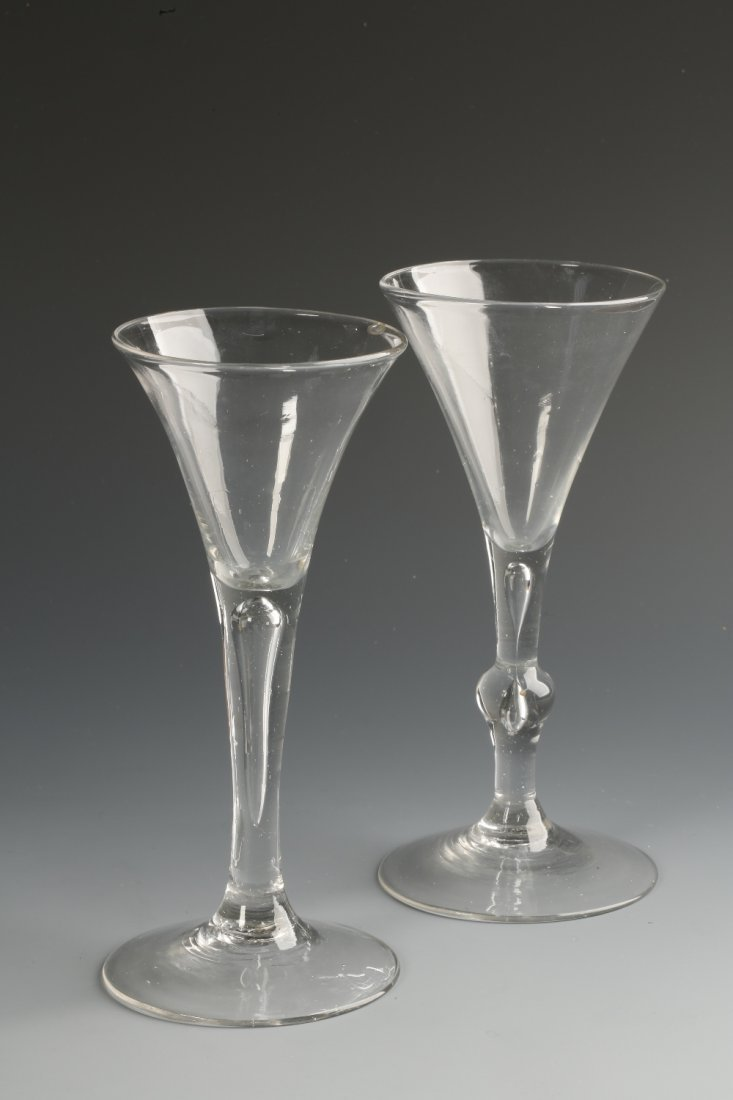 AN 18TH CENTURY WINE GLASS with a flared trumpet-shaped