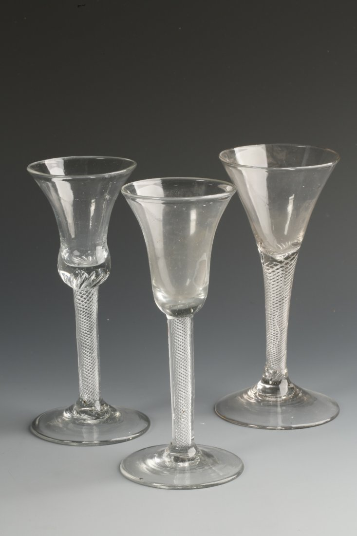 AN 18TH CENTURY WINE GLASS with a thistle-shaped bowl o