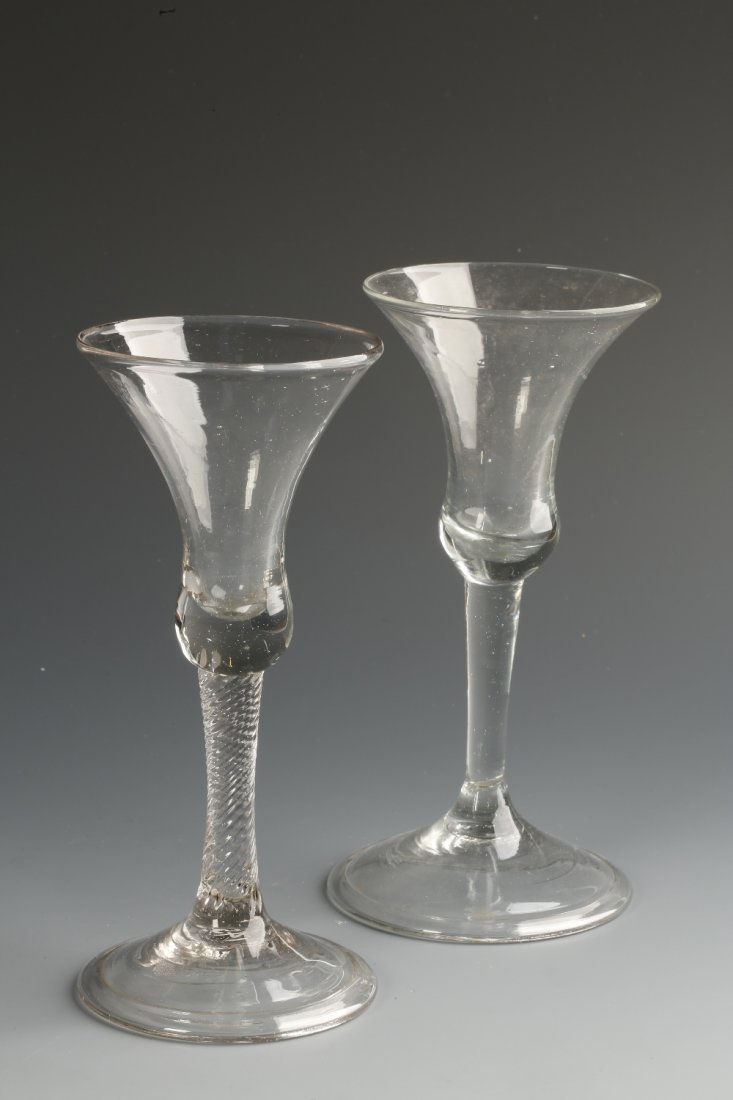 AN 18TH CENTURY WINE GLASS with a tapering bowl on a sp
