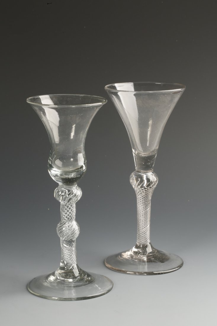 AN 18TH CENTURY WINE GLASS with trumpet-shaped bowl and