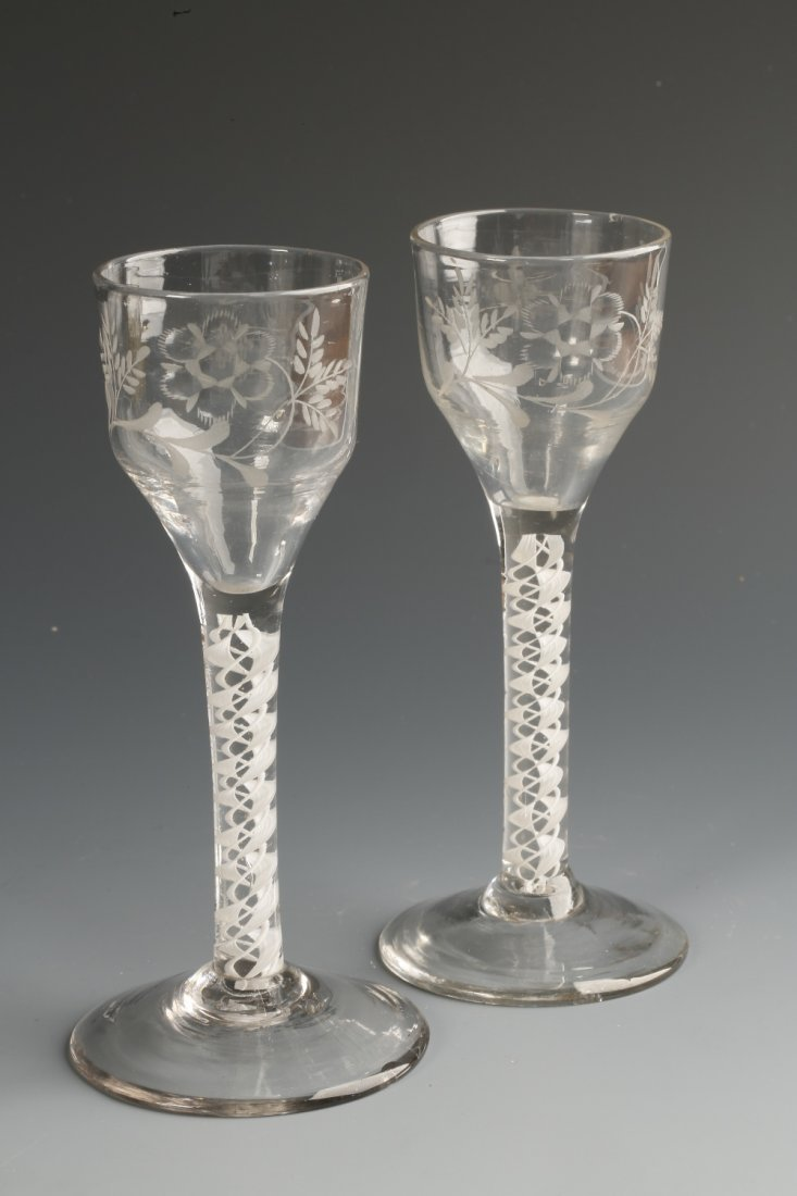 A NEAR PAIR OF 18TH CENTURY WINE GLASSES, the straight-