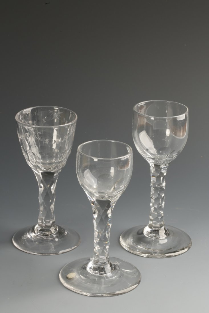 AN 18TH CENTURY WINE GLASS with faceted stem, the bowl