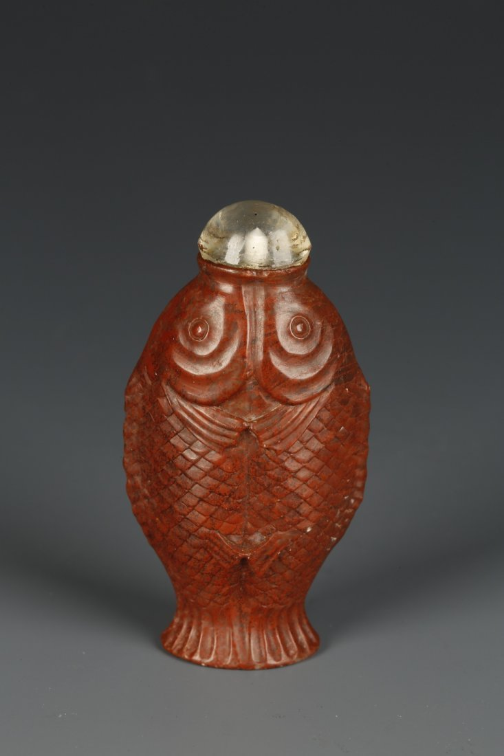 A RED SOAPSTONE SNUFF BOTTLE in the form of two