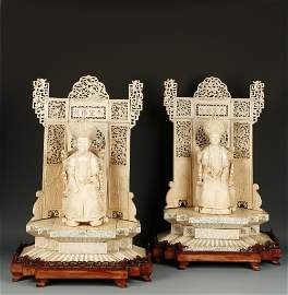 A LARGE PAIR OF CHINESE IVORY THRONE FIGURES of the
