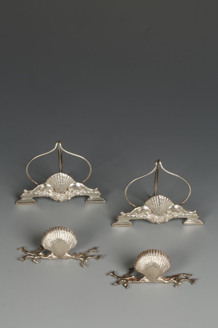 A PAIR OF VICTORIAN CAST MENU CARD HOLDERS modelled as