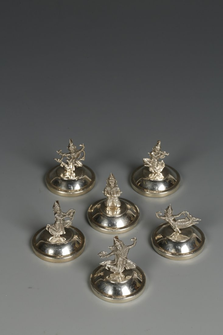 A SET OF SIX MENU CARD HOLDERS in the form of deities,