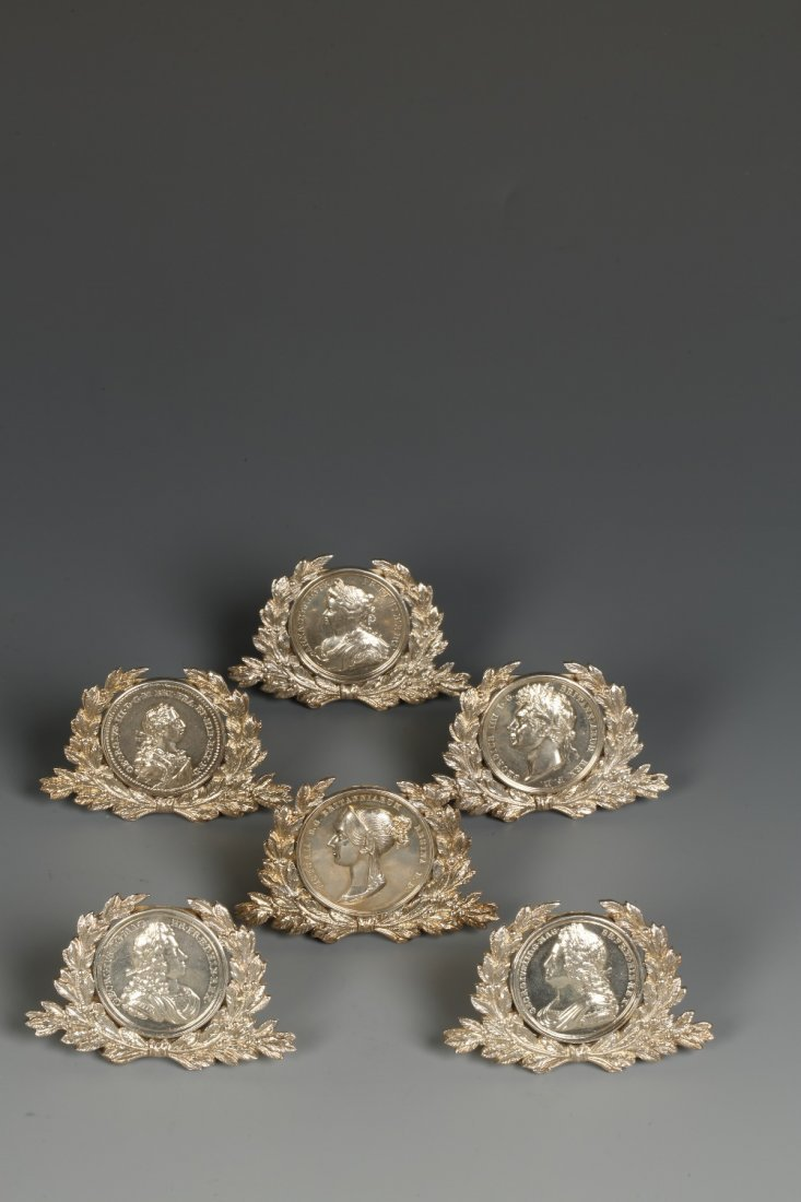 A SET OF SIX EDWARDIAN MENU CARD HOLDERS in the form of