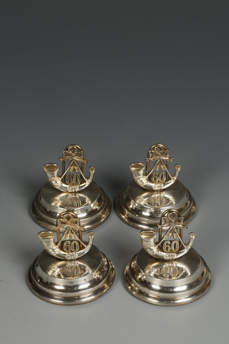 A SET OF FOUR PARCEL GILT MENU CARD HOLDERS modelled as