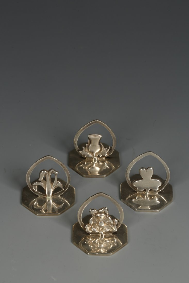 A SET OF FOUR EDWARDIAN MENU CARD HOLDERS modelled in